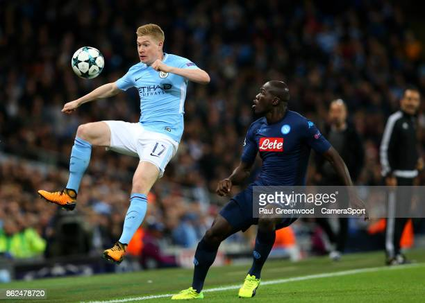 Kevin De Bruyne competes with Kalidou Koulibaly during the UEFA Champions League group F match between Manchester City and SSC Napoli at Etihad...
