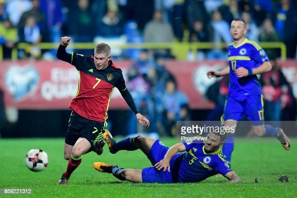 Kevin De Bruyne forward of Belgium is tackled by Sead Kolasinac defender of Bosnia Herzegovina during the World Cup Qualifier Group H match between...