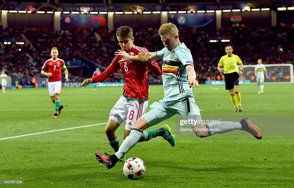 <a gi-track='captionPersonalityLinkClicked' href=/galleries/search?phrase=Kevin+De+Bruyne&family=editorial&specificpeople=6165471 ng-click='$event.stopPropagation()'>Kevin De Bruyne</a> of Belgium and Adam Nagy of Hungary compete for the ball during the UEFA EURO 2016 round of 16 match between Hungary and Belgium at Stadium Municipal on June 26, 2016 in Toulouse, France.