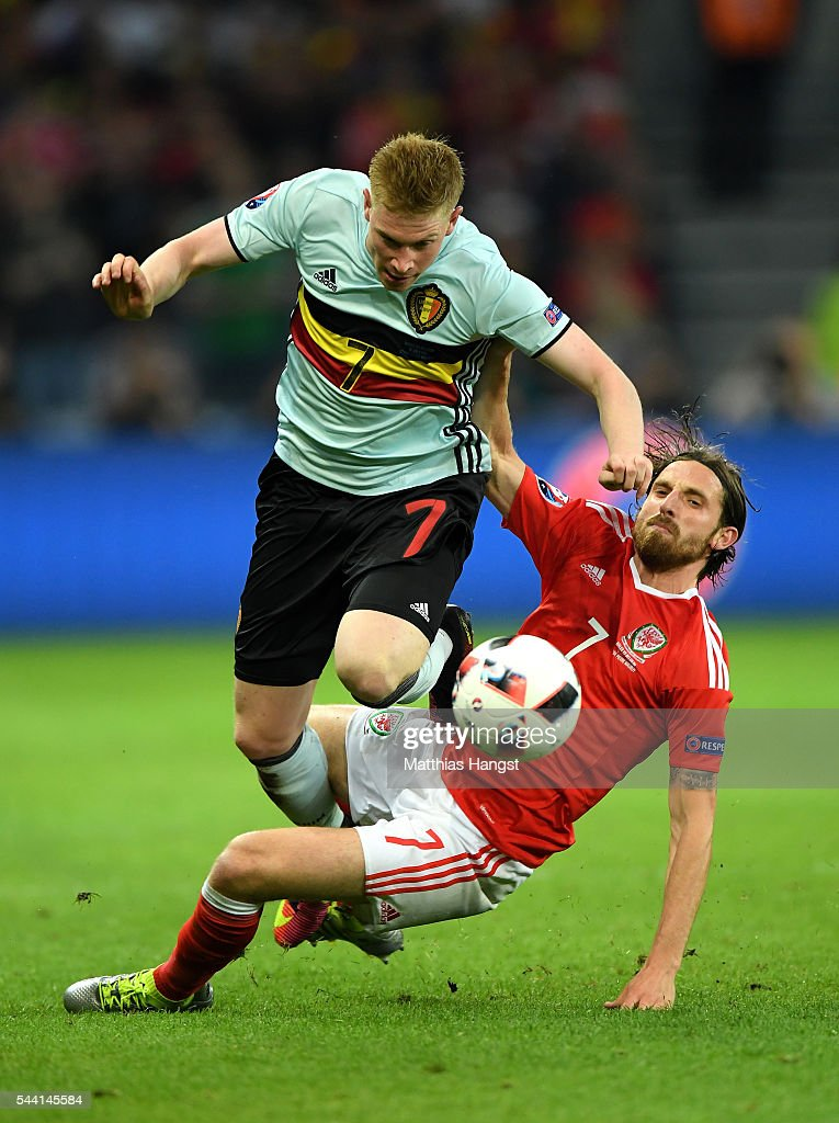 <a gi-track='captionPersonalityLinkClicked' href=/galleries/search?phrase=Kevin+De+Bruyne&family=editorial&specificpeople=6165471 ng-click='$event.stopPropagation()'>Kevin De Bruyne</a> of Belgium is tackled by <a gi-track='captionPersonalityLinkClicked' href=/galleries/search?phrase=Joe+Allen+-+Welsh+Soccer+Player&family=editorial&specificpeople=9629091 ng-click='$event.stopPropagation()'>Joe Allen</a> of Wales during the UEFA EURO 2016 quarter final match between Wales and Belgium at Stade Pierre-Mauroy on July 1, 2016 in Lille, France.
