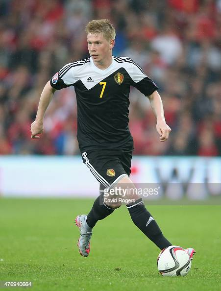 Kevin de Bruyne of Belgium runs with the ball challenges during the UEFA EURO 2016 qualifying match between Wales and Belgium at the Cardiff City...