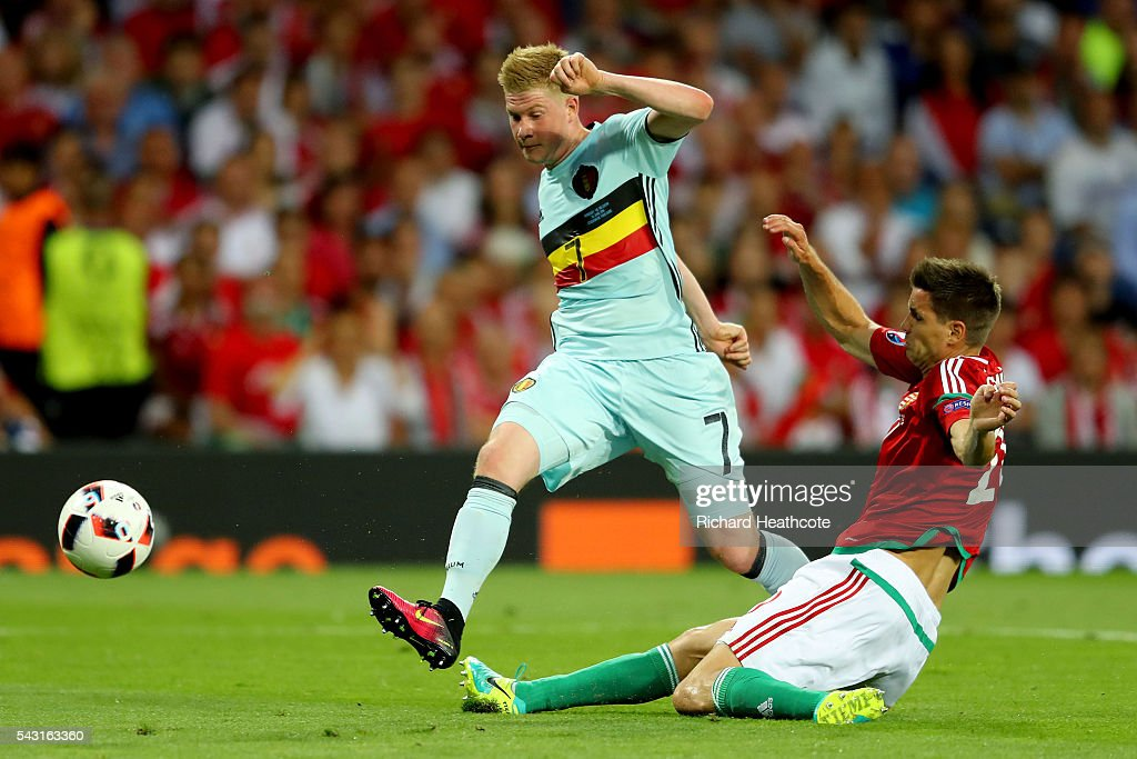 <a gi-track='captionPersonalityLinkClicked' href=/galleries/search?phrase=Kevin+De+Bruyne&family=editorial&specificpeople=6165471 ng-click='$event.stopPropagation()'>Kevin De Bruyne</a> of Belgium shoots at goal while Richard Guzmics of Hungary tries to block during the UEFA EURO 2016 round of 16 match between Hungary and Belgium at Stadium Municipal on June 26, 2016 in Toulouse, France.