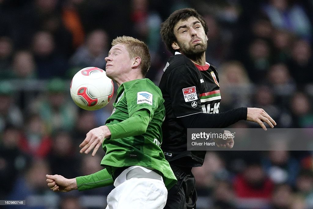Kevin De Bruyne (L) of Bremen and Jan Moravek (R) of Augsburg battle for the ball during the Bundesliga match between SV Werder Bremen and FC Augsburg at Weser Stadium on March 2, 2013 in Bremen, Germany.