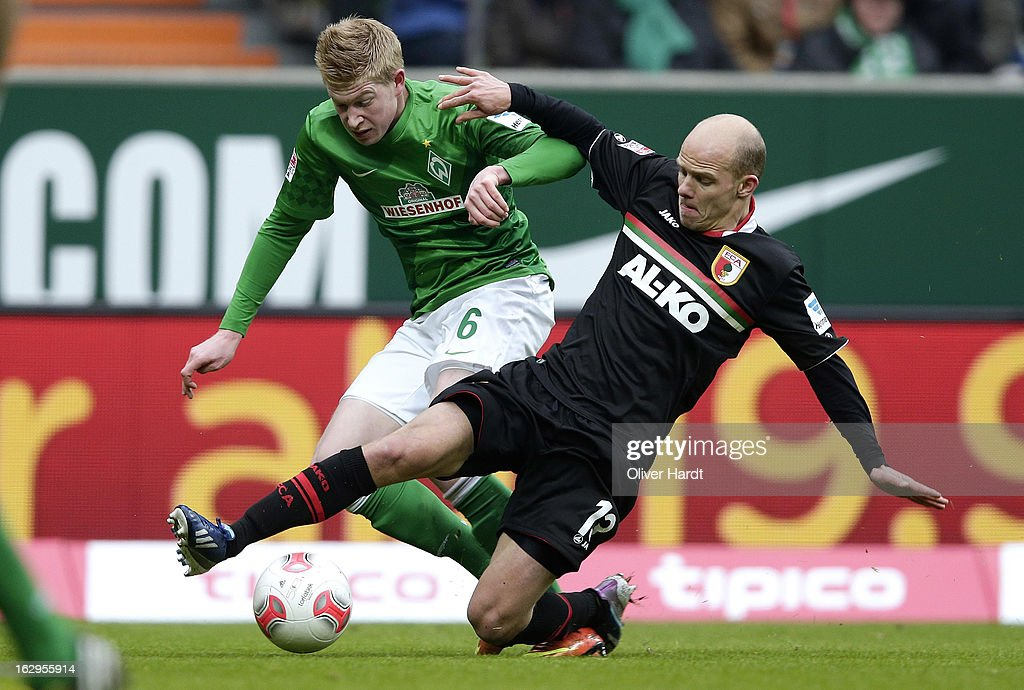 <a gi-track='captionPersonalityLinkClicked' href=/galleries/search?phrase=Kevin+De+Bruyne&family=editorial&specificpeople=6165471 ng-click='$event.stopPropagation()'>Kevin De Bruyne</a> (L) of Bremen and Tobias Wagner (R) of Augsburg battle for the ball during the Bundesliga match between SV Werder Bremen and FC Augsburg at Weser Stadium on March 2, 2013 in Bremen, Germany.