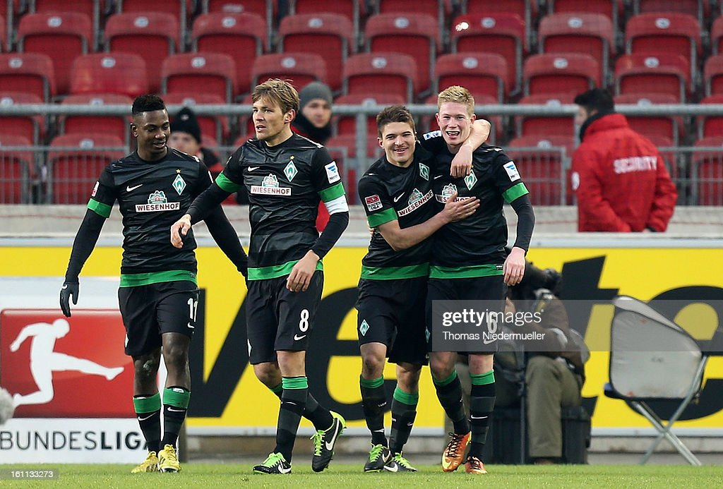 Kevin de Bruyne (R) of Bremen celebrates his goal with <a gi-track='captionPersonalityLinkClicked' href=/galleries/search?phrase=Aleksandar+Ignjovski&family=editorial&specificpeople=6129439 ng-click='$event.stopPropagation()'>Aleksandar Ignjovski</a> (2ndR), <a gi-track='captionPersonalityLinkClicked' href=/galleries/search?phrase=Eljero+Elia&family=editorial&specificpeople=2199495 ng-click='$event.stopPropagation()'>Eljero Elia</a> (L) and <a gi-track='captionPersonalityLinkClicked' href=/galleries/search?phrase=Clemens+Fritz&family=editorial&specificpeople=645695 ng-click='$event.stopPropagation()'>Clemens Fritz</a> (2ndL) of Bremen during the Bundesliga match between VfB Stuttgart and Werder Bremen at Mercedes-Benz Arena on February 9, 2013 in Stuttgart, Germany.