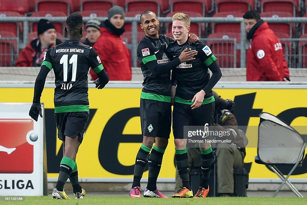 Kevin de Bruyne (R) of Bremen celebrates his goal with Theodor Gerbe Selassie and <a gi-track='captionPersonalityLinkClicked' href=/galleries/search?phrase=Eljero+Elia&family=editorial&specificpeople=2199495 ng-click='$event.stopPropagation()'>Eljero Elia</a> (L) of Bremen during the Bundesliga match between VfB Stuttgart and Werder Bremen at Mercedes-Benz Arena on February 9, 2013 in Stuttgart, Germany.