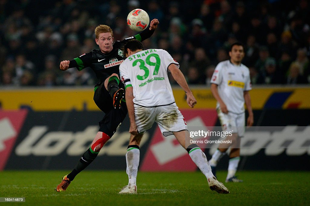 <a gi-track='captionPersonalityLinkClicked' href=/galleries/search?phrase=Kevin+De+Bruyne&family=editorial&specificpeople=6165471 ng-click='$event.stopPropagation()'>Kevin De Bruyne</a> of Bremen loops the ball over <a gi-track='captionPersonalityLinkClicked' href=/galleries/search?phrase=Martin+Stranzl&family=editorial&specificpeople=674140 ng-click='$event.stopPropagation()'>Martin Stranzl</a> of Moenchengladbach during the Bundesliga match between VfL Borussia Moenchengladbach and SV Werder Bremen at Borussia Park Stadium on March 9, 2013 in Moenchengladbach, Germany.