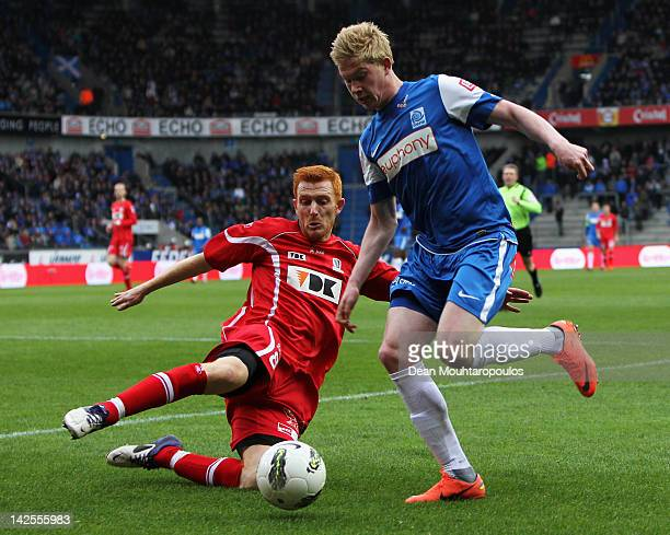 Kevin De Bruyne of Genk attempts the cross as defender Bernd Thijs of Gent comes in for the tackle during the Jupiler League match between KRC Genk...