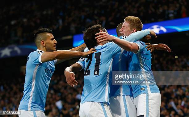 Kevin De Bruyne of Man City celebrates scoring the winning goal with his team mates Sergio Aguero David Silva Fernando and Fernandinho during the...