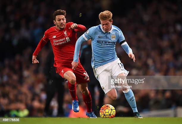 Kevin de Bruyne of Manchester City and Adam Lallana of Liverpool compete for the ball during the Barclays Premier League match between Manchester...