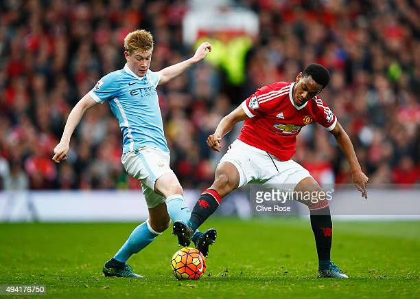 Kevin de Bruyne of Manchester City and Anthony Martial of Manchester United compete for the ball during the Barclays Premier League match between...