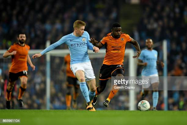 Kevin De Bruyne of Manchester City and Bright Enobakhare of Wolverhampton Wanderers battle for the ball during the Carabao Cup Fourth Round match...