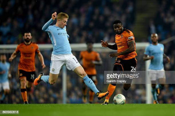 Kevin De Bruyne of Manchester City and Bright Enobakhare of Wolverhampton Wanderers in action during the Carabao Cup Fourth Round match between...