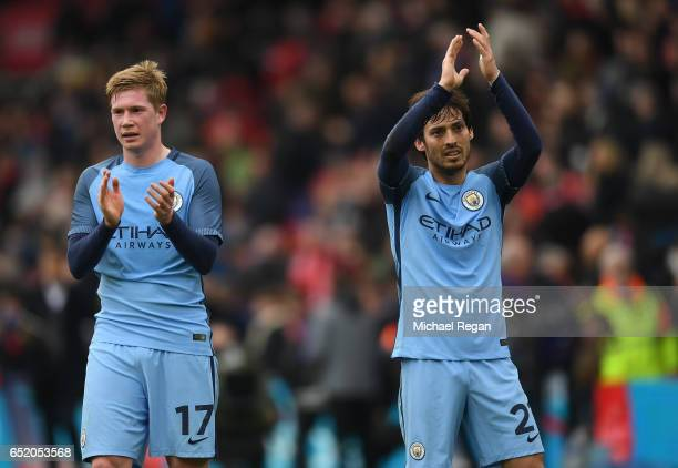 Kevin De Bruyne of Manchester City and David Silva of Manchester City show appreciation to the fans after The Emirates FA Cup QuarterFinal match...
