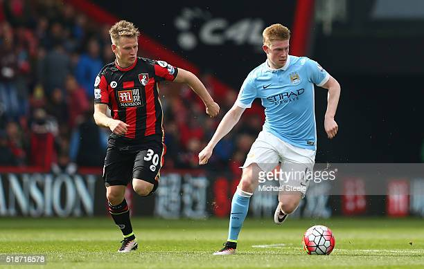Kevin de Bruyne of Manchester City and Matt Ritchie of Bournemouth compete for the ball during the Barclays Premier League match between AFC...