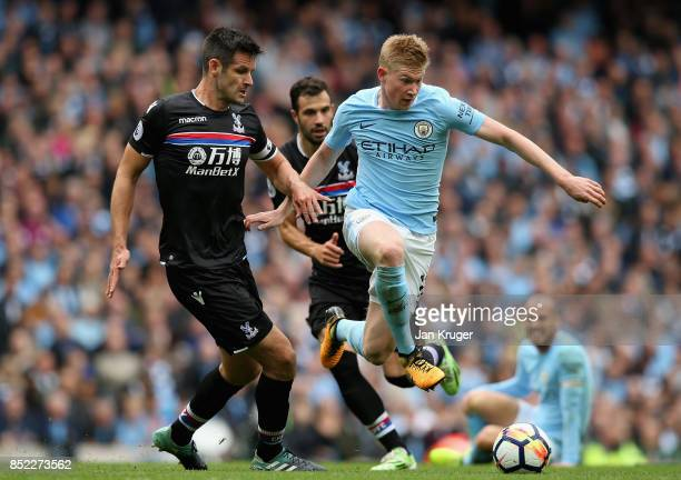 Kevin De Bruyne of Manchester City and Scott Dann of Crystal Palace compete for the ball during the Premier League match between Manchester City and...