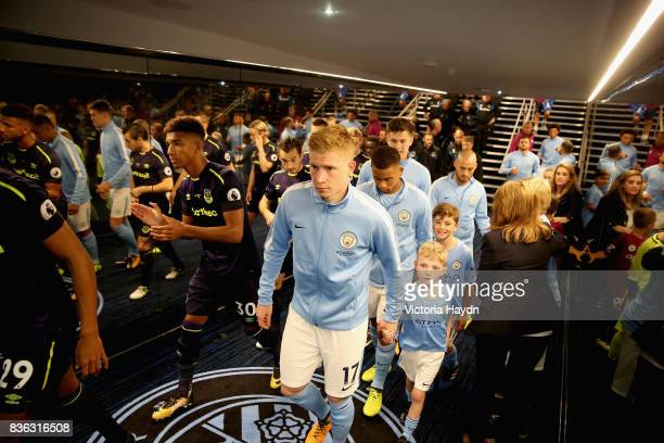 Kevin De Bruyne of Manchester City and teams walk out tunnel prior to the Premier League match between Manchester City and Everton at Etihad Stadium...