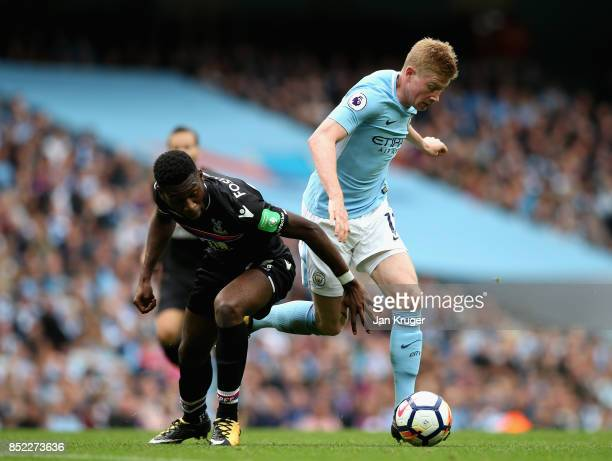 Kevin De Bruyne of Manchester City and Timothy FosuMensah of Crystal Palace compete for the ball during the Premier League match between Manchester...