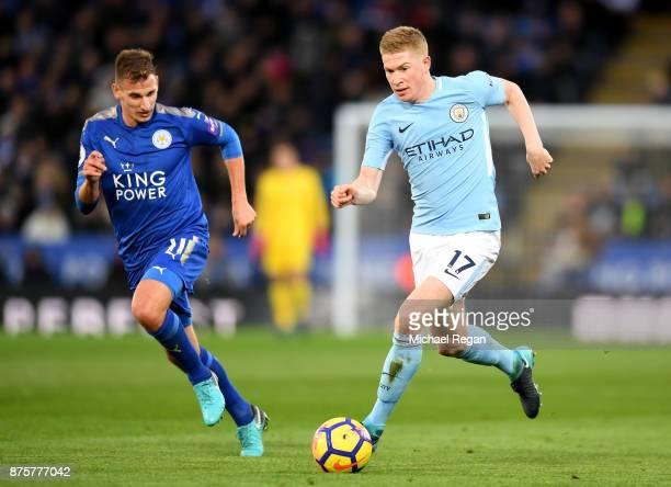 Kevin De Bruyne of Manchester City and Vicente Iborra of Leicester City compete for the ball during the Premier League match between Leicester City...