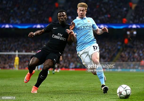 Kevin de Bruyne of Manchester City battles with Serge Aurier of Paris SaintGermain during the UEFA Champions League quarter final second leg match...