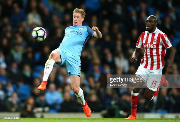 Kevin De Bruyne of Manchester City breaks through on goal as he is closed down by Bruno Martins Indi of Stoke City during the Premier League match...