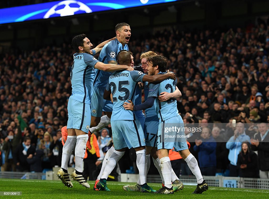Kevin De Bruyne of Manchester City (C) celebrates scoring his sides second goal with his Manchester City team mates during the UEFA Champions League Group C match between Manchester City FC and FC Barcelona at Etihad Stadium on November 1, 2016 in Manchester, England.