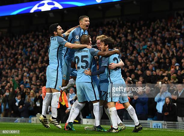Kevin De Bruyne of Manchester City celebrates scoring his sides second goal with his Manchester City team mates during the UEFA Champions League...