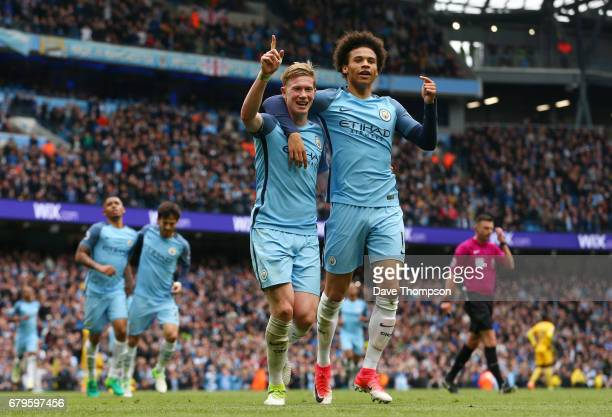 Kevin De Bruyne of Manchester City celebrates scoring his sides third goal with Leroy Sane of Manchester City during the Premier League match between...