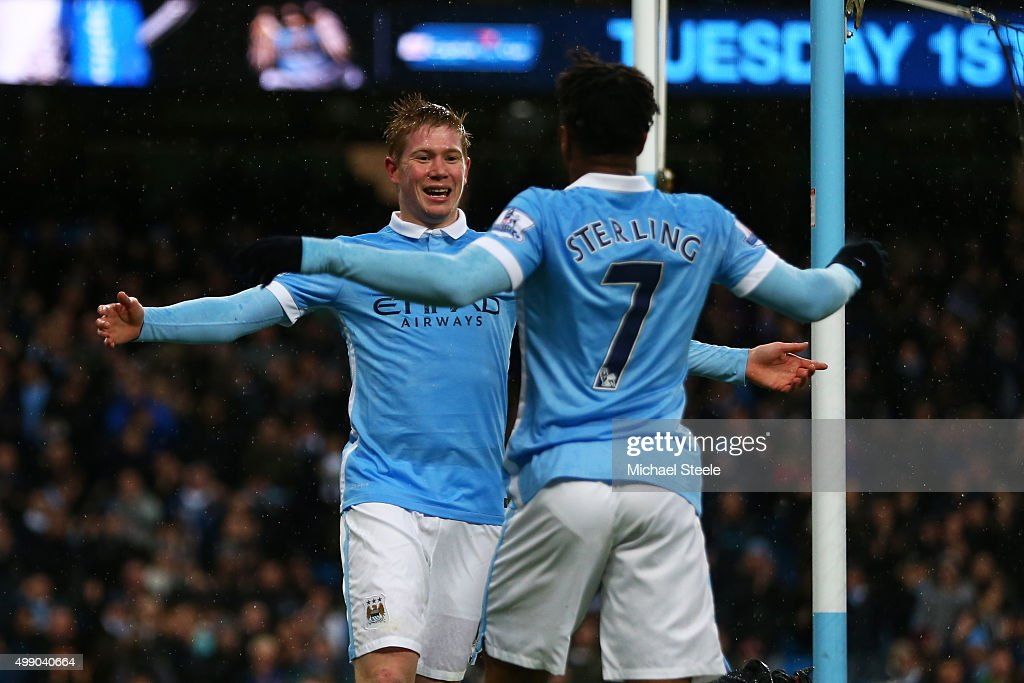 Kevin de Bruyne (L) of Manchester City celebrates scoring his team's first goal with his team mate <a gi-track='captionPersonalityLinkClicked' href=/galleries/search?phrase=Raheem+Sterling&family=editorial&specificpeople=6489439 ng-click='$event.stopPropagation()'>Raheem Sterling</a> (R) during the Barclays Premier League match between Manchester City and Southampton at the Etihad Stadium on November 28, 2015 in Manchester, England.