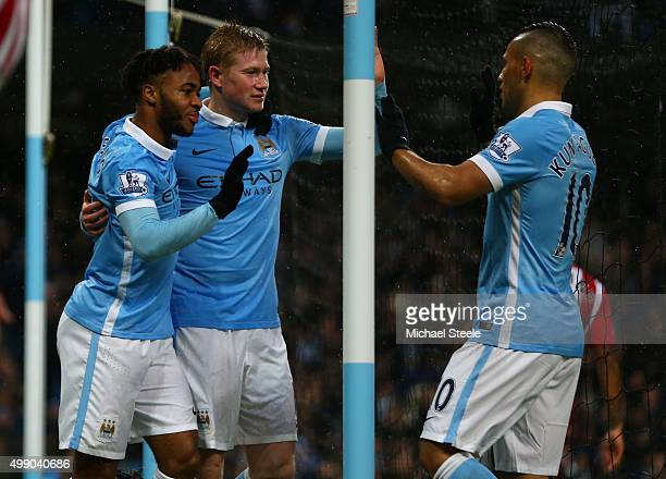 Kevin de Bruyne of Manchester City celebrates scoring his team's first goal with his team mates Raheem Sterling and Sergio Aguero during the Barclays...