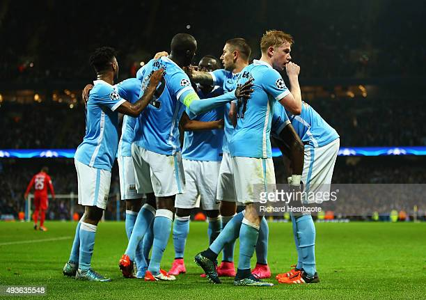 Kevin De Bruyne of Manchester City celebrates scoring his team's second goal with team mates during the UEFA Champions League Group D match between...