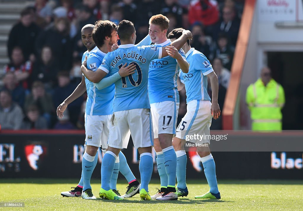 Kevin de Bruyne (2nd R) of Manchester City celebrates scoring his team's second goal with his team mates during the Barclays Premier League match between A.F.C. Bournemouth and Manchester City at Vitality Stadium on April 2, 2016 in Bournemouth, England.