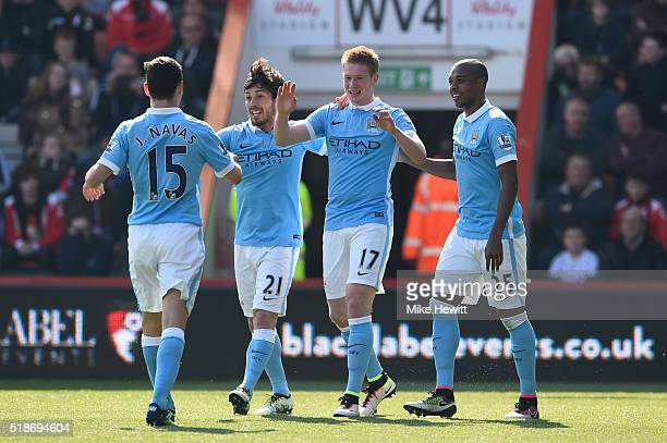 Kevin de Bruyne of Manchester City celebrates scoring his team's second goal with his team mates during the Barclays Premier League match between AFC...