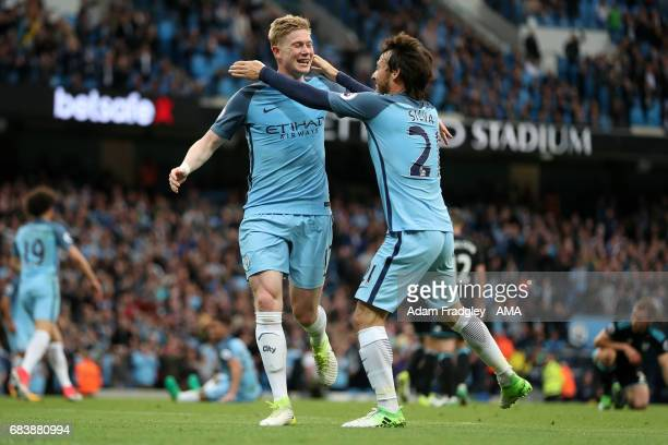 Kevin De Bruyne of Manchester City celebrates with David Silva after scoring a goal to make it 20 during the Premier League match between Manchester...