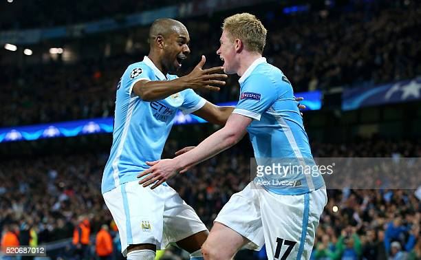 Kevin de Bruyne of Manchester City celebrates with Fernandinho as he scores their first goal during the UEFA Champions League quarter final second...