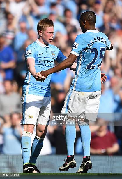 Kevin de Bruyne of Manchester City celebrates with Fernandinho of Manchester City after scoring his side's second goal during the Barclays Premier...