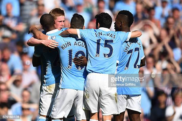 Kevin de Bruyne of Manchester City celebrates with his team mates after scoring his side's second goal during the Barclays Premier League match...
