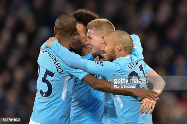 Kevin de Bruyne of Manchester City celebrates with team mates after he put his team 20 ahead during the Premier League match between Leicester City...