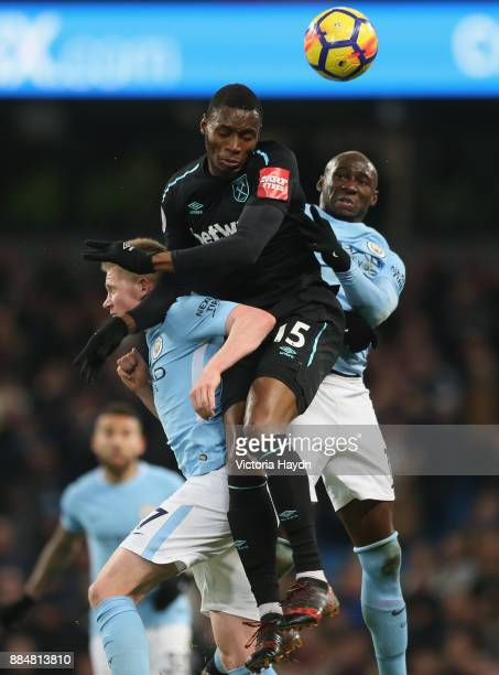 Kevin De Bruyne of Manchester City Diafra Sakho of West Ham United and Eliaquim Mangala of Manchester City battle for possession in the air during...