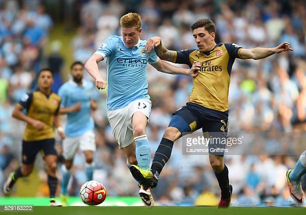 Kevin de Bruyne of Manchester City holds off Hector Bellerin of Arsenal on way to scoring his side's second goal during the Barclays Premier League...