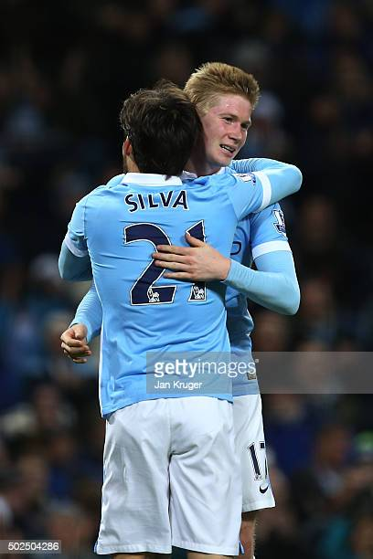 Kevin De Bruyne of Manchester City is congratulated by teammate David Silva after scoring his team's fourth goal during the Barclays Premier League...