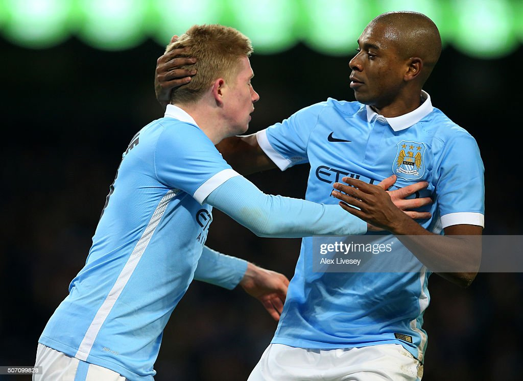 Kevin De Bruyne of Manchester City is congratulated by teammate Fernandinho after scoring his team;s second goal during the Capital One Cup Semi Final, second leg match between Manchester City and Everton at the Etihad Stadium on January 27, 2016 in Manchester, England.