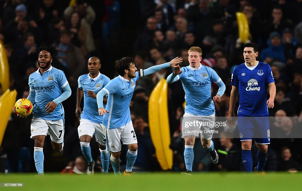 Kevin De Bruyne (2nd R) of Manchester City is congratulated teammate David Silva of Manchester City after scoring his team's second goal during the Capital One Cup Semi Final, second leg match between Manchester City and Everton at the Etihad Stadium on January 27, 2016 in Manchester, England.