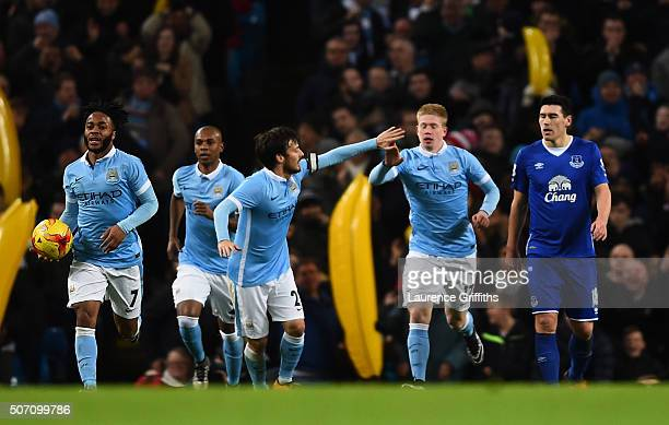 Kevin De Bruyne of Manchester City is congratulated teammate David Silva of Manchester City after scoring his team's second goal during the Capital...