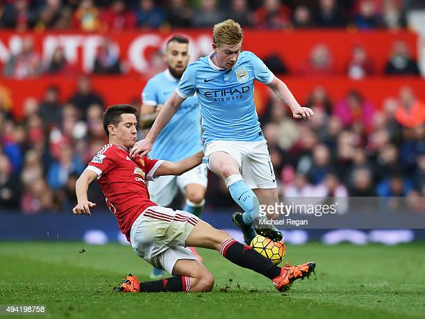 Kevin de Bruyne of Manchester City is tackled by Ander Herrera of Manchester United during the Barclays Premier League match between Manchester...