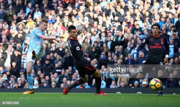 Kevin De Bruyne of Manchester City scores his sides first goal during the Premier League match between Manchester City and Arsenal at Etihad Stadium...