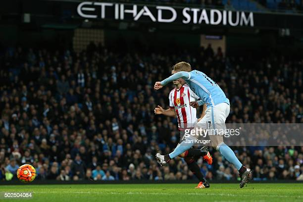 Kevin De Bruyne of Manchester City scores his team's fourth goal during the Barclays Premier League match between Manchester City and Sunderland at...