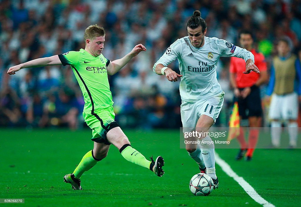 Kevin de Bruyne of Manchester City tackles Gareth Bale of Real Madrid during the UEFA Champions League semi final, second leg match between Real Madrid and Manchester City FC at Estadio Santiago Bernabeu on May 4, 2016 in Madrid, Spain.