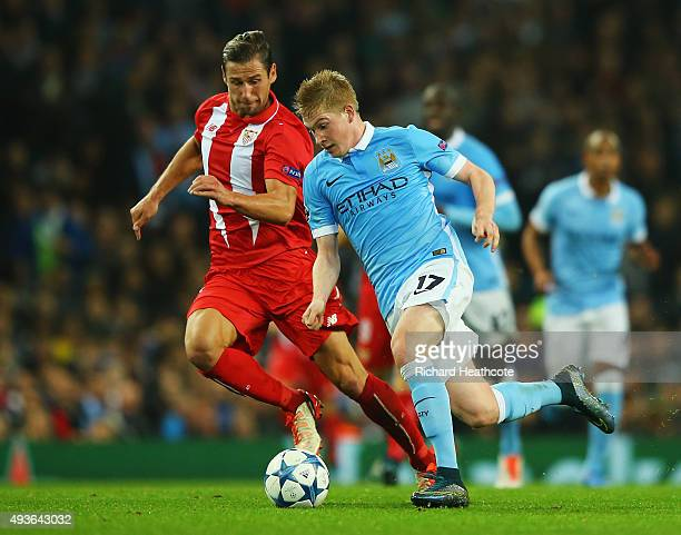Kevin De Bruyne of Manchester City takes on Grzegorz Krychowiak of Sevilla during the UEFA Champions League Group D match between Manchester City and...