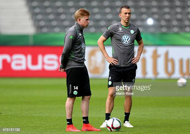 Kevin de Bruyne of VfL Wolfsburg and Ivan Perisic of VfL Wolfsburg look on during the DFB Cup Final 2015 training session at Olympiastadion on May 29...